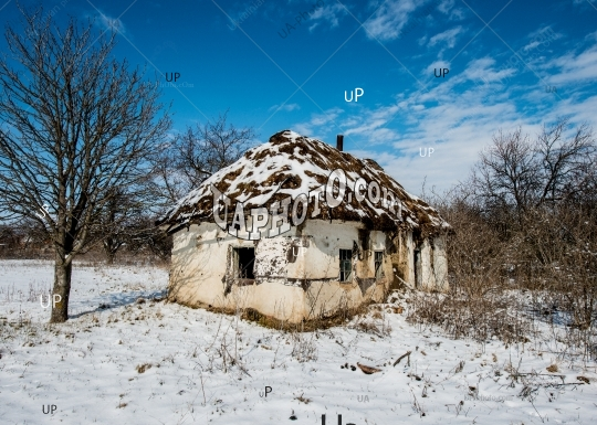 Abandoned Old Clay House with Thatched Roof.