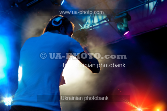 DJ performs at night disco