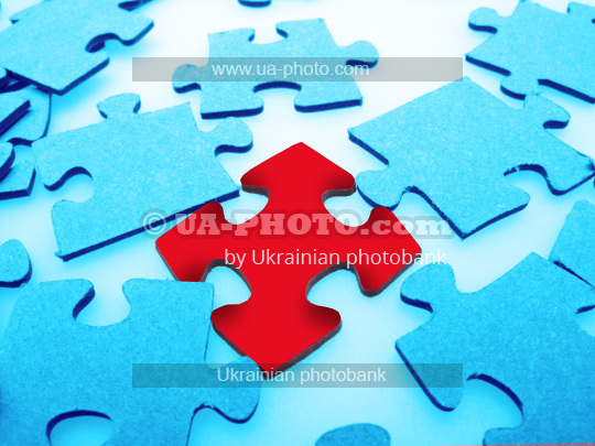 Jigsaw puzzle pieces, closeup