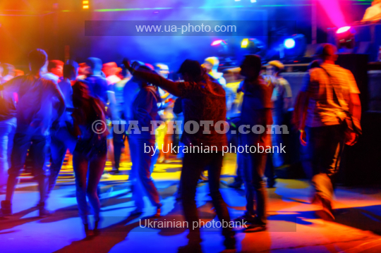 people relax and dance in a disco