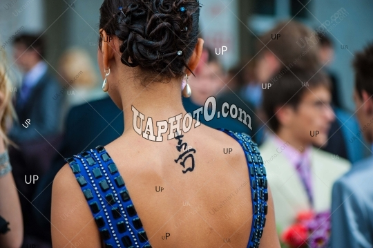 tattoo on the back of a woman, social event at a holiday.